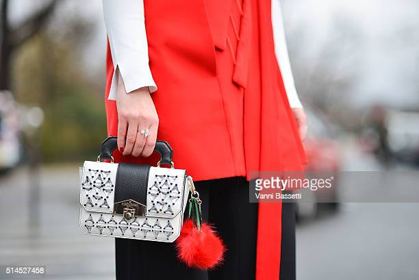 Angelica Ardasheva poses with a Hibourama bag before the Moncler Gamme Rouge show at the Grand Palais during Paris Fashion Week FW 16/17 on March 9...