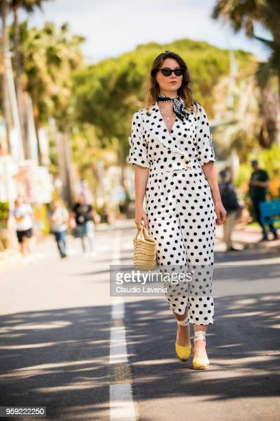 Angelica Ardasheva wearing a Asos black and white dots dress is seen in the streets of Cannes during the 71st annual Cannes Film Festival on May 16...