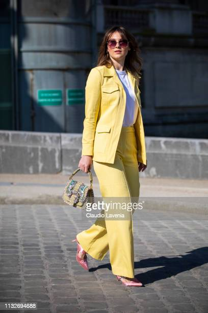 Angelica Ardasheva wearing a yellow suit white tshirt pink heels and a decorated bag is seen outside Maison Margiela on Day 3 Paris Fashion Week...