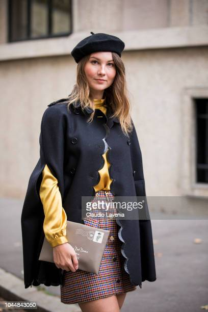 Angelica Ardasheva wearing a yellow top checked mini skirt black cape black beret and beige clutch is seen after the Miu Miu show on October 2 2018...