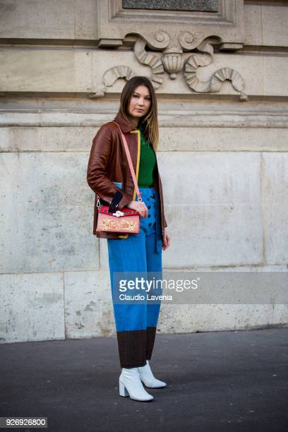 Angelica Ardasheva wearing brown leather jacket and green sweater is seen in the streets of Paris before the Vivienne Westwood show during Paris...
