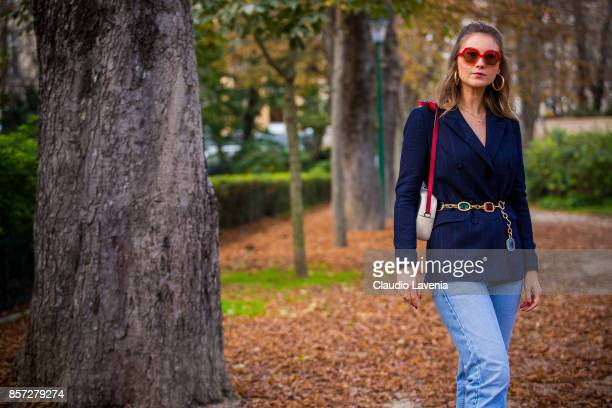 Angelica Ardasheva wearing Maryling jacket Maxco vintage sunglasses Levis 501 pants and Gucci bag is seen after the Moncler Gamme Rouge show during...