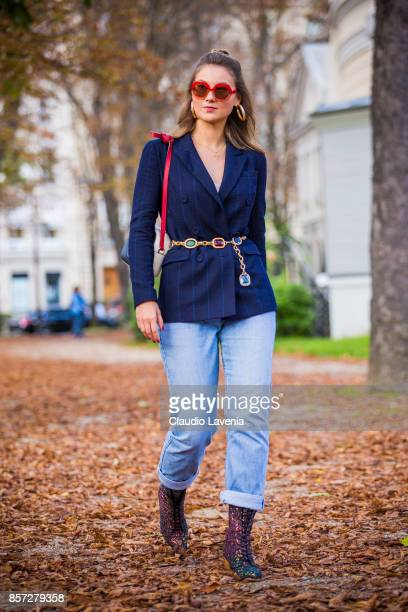 Angelica Ardasheva wearing Maryling jacket Maxco vintage sunglasses Levis 501 pants Mellow Yellow boots and Gucci bag is seen after the Moncler Gamme...