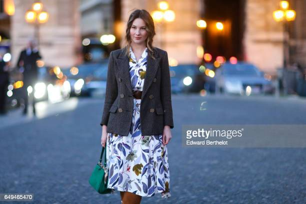 Angelica Ardasheva wears a blazer jacket a flower print dress brown suede boots and a green bag outside the Louis Vuitton show during Paris Fashion...