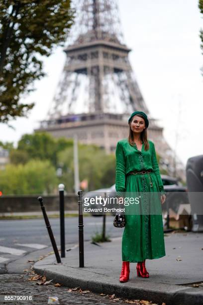 Angelica Ardasheva wears a green dress red shoes outside Kaviar Gauche during Paris Fashion Week Womenswear Spring/Summer 2018 on September 29 2017...