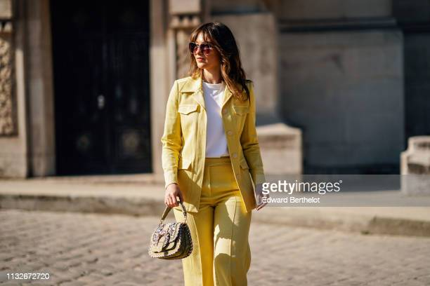Angelica Ardasheva wears a yellow jacket flared pants a bag a white top outside Maison Margiela during Paris Fashion Week Womenswear Fall/Winter...