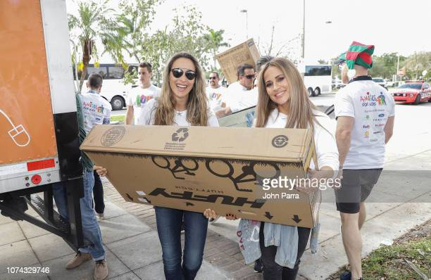 Angelica Castro and Jackie Guerrido attend the Amigos For Kids 27th Annual Holiday Toy Drive on December 16 2018 in Miami Florida