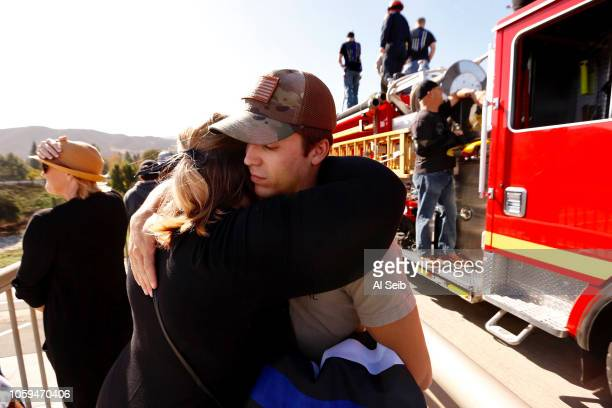 Angelica Crosswhite hugs her nephew Kyle Legge whos dad serves is a Ventura County Sheriff serving under Sgt Ron Helus the Ventura Co Sheriff's...