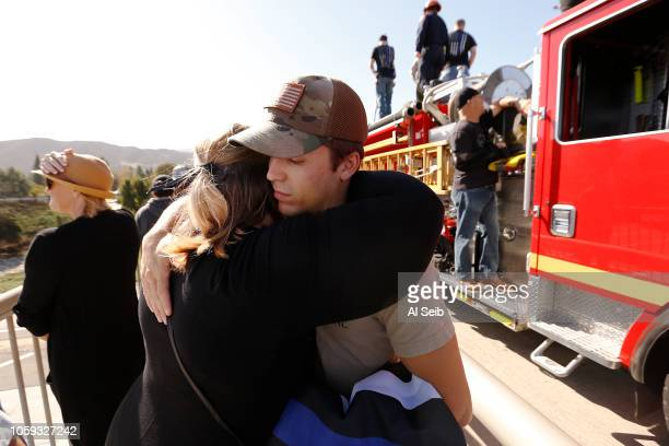 Angelica Crosswhite hugs her nephew Kyle Legge whose dad serves as a Ventura County Sheriff serving under Sgt Ron Helus who was killed yesterday in...