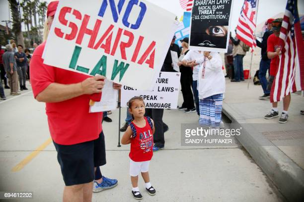 Angelica Del Monte looks at anti Shariah Law sign during the March For Human rights and Against Sharia law demonstration in Oceanside California on...