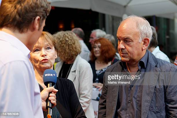 Angelica Domroese and Bernd Boehlich are interviewed on the red carpet at the premiere of 'Bis Zum Horizont Dann Links' at Lichtburg on July 5 2012...