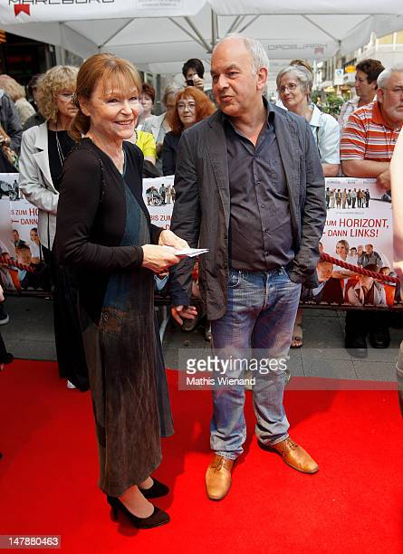Angelica Domroese and Bernd Boehlich walk the red carpet at the premiere of 'Bis Zum Horizont Dann Links' at Lichtburg on July 5 2012 in Essen Germany