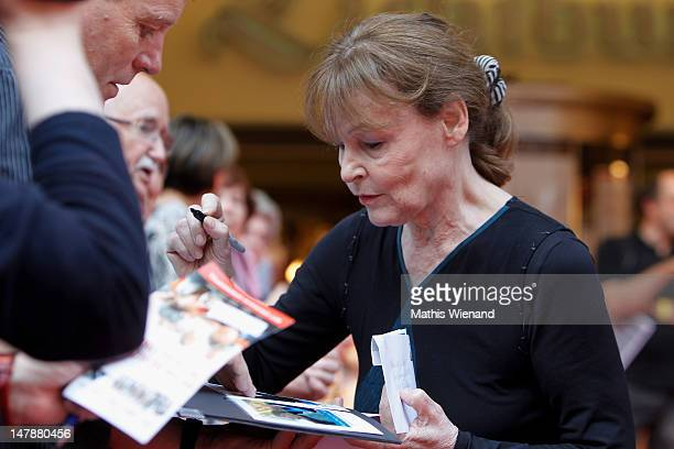 Angelica Domroese signs autographs for fans on the red carpet at the premiere of 'Bis Zum Horizont Dann Links' at Lichtburg on July 5 2012 in Essen...