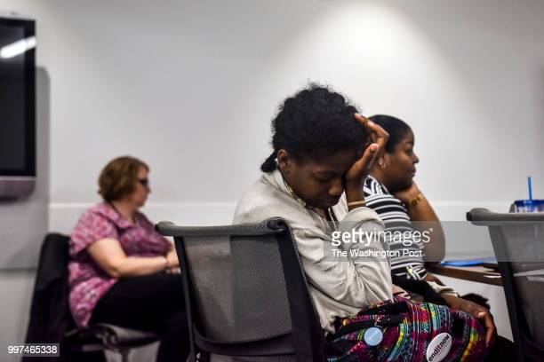 Angelica Dunn holds her weary head in the back of the classroom on the fourth and final day of a job training program at Metropolitan Community...