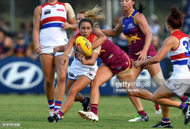 Angelica Gogos of the Bulldogs gets a handball away during the round two AFLW match between the Brisbane Lions and the Western Bulldogs at South Pine...