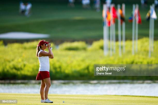 Angelica Moresco of Alabama looks through her rangefinder during the Division I Women's Golf Team Match Play Championship held at the Karsten Creek...