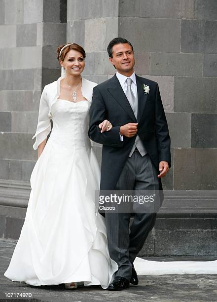 Angelica Rivera and Enrique Pena Nieto greet the public during their religious wedding at Toluca City Cathedral on November 27 2010 in Toluca Mexico