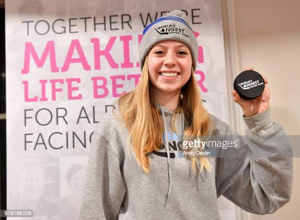 Angelica Saik poses with a puck at the World's Longest Hockey Game on February 16 2018 at Saiker's Acres in Strathcona County Alberta Canada