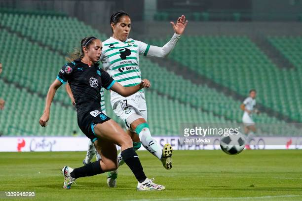 Angelica Torres of Chivas fights for the ball with Marcela Valera of Santos during a match between Santos and Chivas as part of the Torneo Grita...