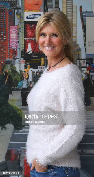 Angelika Meisel stands in front of an oil painting in her apartment in KissingGermany 29 October 2015 The 50 year old who had to fight against a...