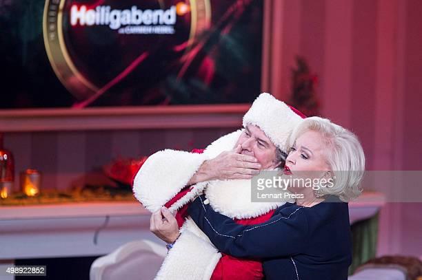 Angelika Milster and Andy Borg as Santa Borg attend the 'Heiligabend mit Carmen Nebel' TV show at Bavaria Filmstudios on November 26 2015 in Munich...