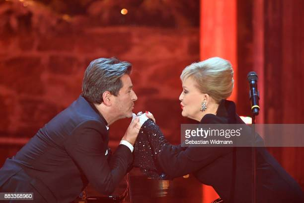 Angelika Milster and Thomas Anders perform during the tv show 'Heiligabend mit Carmen Nebel' on November 29 2017 in Munich Germany The show will be...
