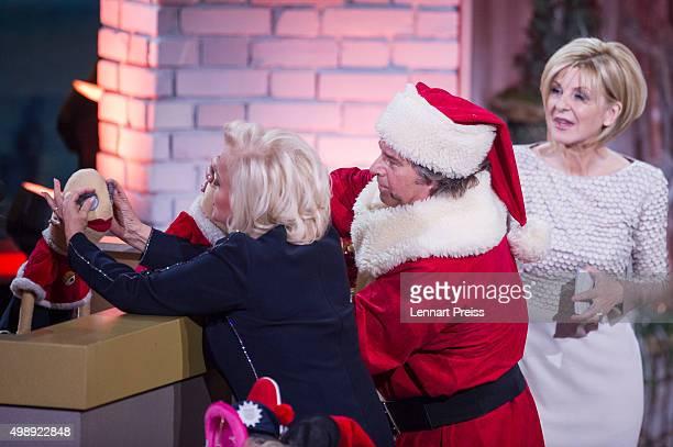 Angelika Milster Andy Borg as Santa Borg and Carmen Nebel attend the 'Heiligabend mit Carmen Nebel' TV show at Bavaria Filmstudios on November 26...