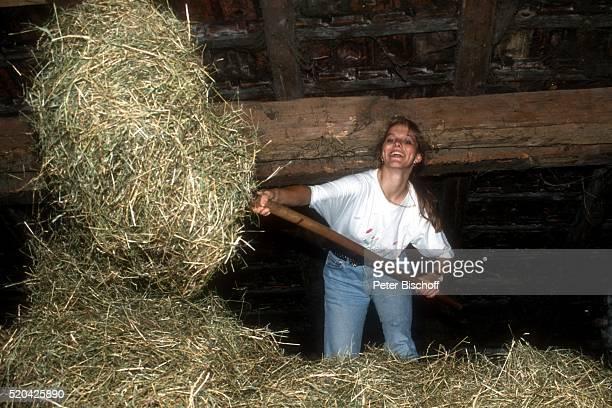 Angelika Reißner am beim Ferien-Appartement ihrer Eltern auf einem Bauernhof bei Rosenheim, Deutschland.