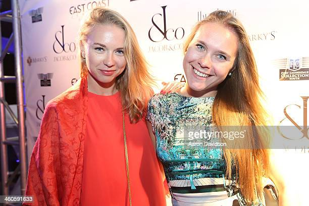 Angelika Timanina and Daria Tienbusch attend Haute Time Russia Hosts Jacob Co And ECJ Holiday Party at Sunny Isles Beach Gallery on January 3 2014 in...