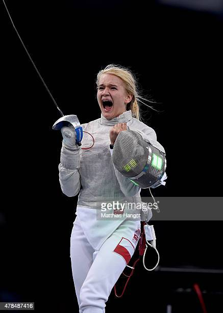Angelika Wator of Poland celebrates victory over Sevinc Bunyatova of Azerbaijan in the Women's Fencing Individual Sabre Semi Final during day...