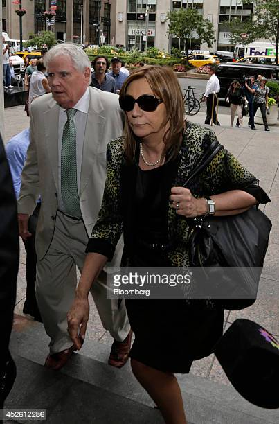 Angelina Abbona attorney for the Argentine Treasury right arrives for debt talks in New York US on Thursday July 24 2014 Argentine dollar bonds led...