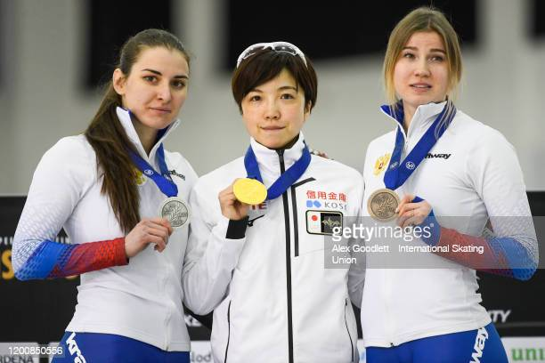 Angelina Golikova of Russia Nao Kodaira of Japan and Olga Fatkulina of Russia stand on the podium after the ladies' 500 meter during the ISU World...