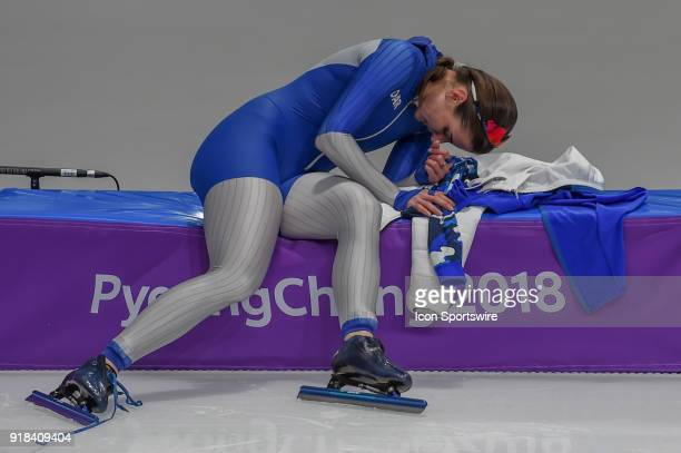 Angelina Golikova recuperates on the track barrier following the 1000M Ladies Final during the 2018 Winter Olympic Games at Gangneung Oval on...