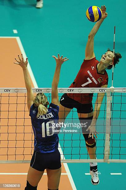 Angelina Grun of Germany smashes as Helene Schleck of France blocks during the women Volleyball European Championship match between Germany and...