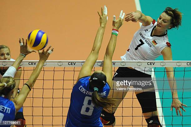 Angelina Grun of Germany smashes as Valentina Arrighetti and Carolina Costagrande of Italy block during the women's Volleyball European Championship...