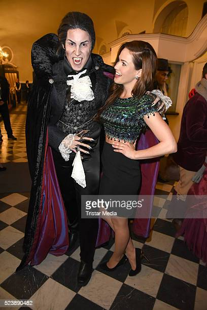 Angelina Heger and a vampire figures attend the 'Tanz der Vampire' Musical Premiere on April 24 2016 in Berlin Germany