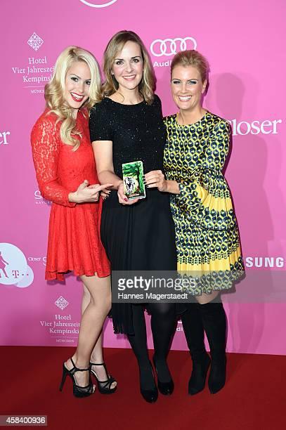 Angelina Heger, Denise Zich and Jennifer Knaeble attend the 'CLOSER Magazin Hosts SMILE Award 2014' at Hotel Vier Jahreszeiten on November 4, 2014 in...
