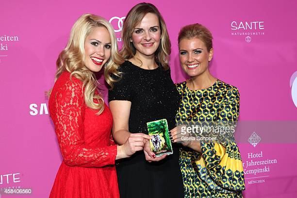 Angelina Heger Denise Zich Jennifer Knaeble with samsung handy attend the CLOSER Magazin Hosts SMILE Award 2014 at Hotel Vier Jahreszeiten on...