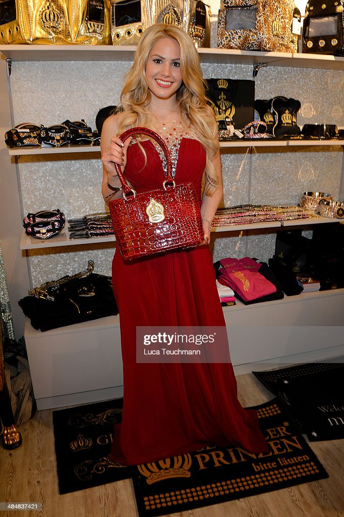 Angelina Heger poses with a handbag the Harald Gloeoeckler Store Opening on April 14, 2014 in Berlin, Germany.