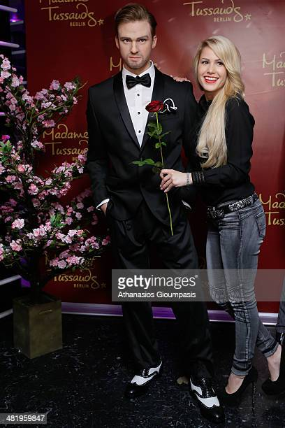 Angelina Heger unveils a Justin Timberlake and Russell Brand wax figure in the newly VIP area at Madame Tussauds on April 2 2014 in Berlin Germany