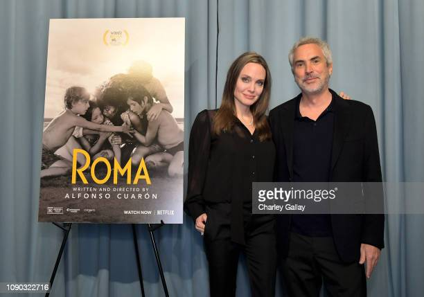 Angelina Jolie and Alfonso Cuarón attend the ROMA Tastemakers Screening and Reception at San Vicente Bungalows on January 05 2019 in West Hollywood...
