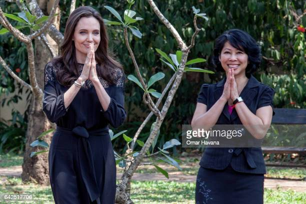 Angelina Jolie and author Loung Ung greet during their arrival at a press conference ahead of the premiere of their new film 'First They Killed My...