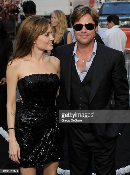 Angelina Jolie and Brad Pitt arrive at the Los Angeles Premiere of Salt at the Grauman's Chinese Theatre on July 19 2010 in Hollywood California