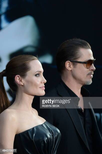 Angelina Jolie and Brad Pitt arrive for the world premiere of Disney's Maleficent May 28 at El Capitan Theatre in Hollywood California AFP PHOTO /...