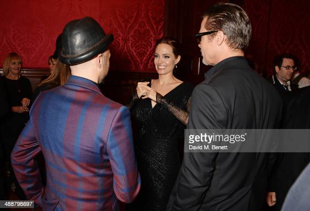 Angelina Jolie and Brad Pitt attend a private reception as costumes and props from Disney's 'Maleficent' are exhibited in support of Great Ormond...