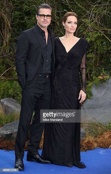 Angelina Jolie and Brad Pitt attend a private reception as costumes and props from Disney's Maleficent are exhibited in support of Great Ormond...