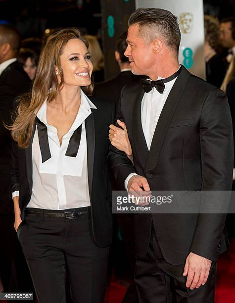 Angelina Jolie and Brad Pitt attend the EE British Academy Film Awards 2014 at The Royal Opera House on February 16 2014 in London England