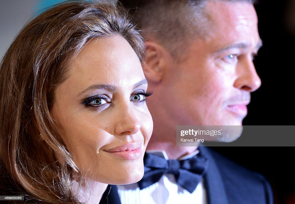 Angelina Jolie and Brad Pitt attend the EE British Academy Film Awards 2014 at The Royal Opera House on February 16, 2014 in London, England.