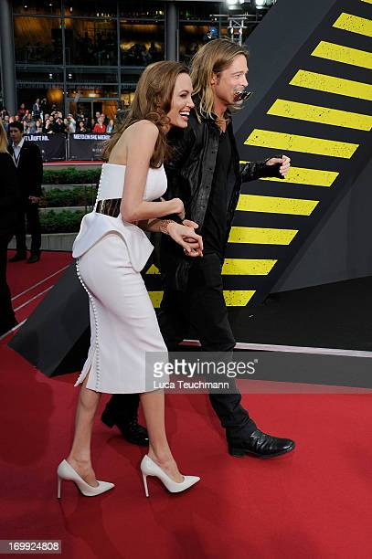 """Angelina Jolie and Brad Pitt attend the premiere of """"World War Z"""" at Sony Centre on June 4, 2013 in Berlin, Germany."""