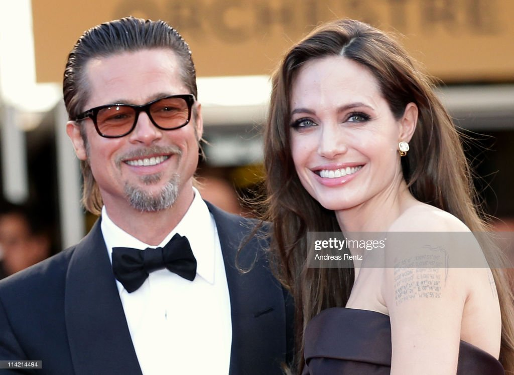 Angelina Jolie (R) and Brad Pitt attend 'The Tree Of Life' premiere during the 64th Annual Cannes Film Festival at Palais des Festivals on May 16, 2011 in Cannes, France.